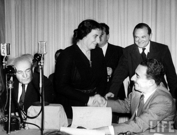 Israel's Foreign Minister Moseh Sharett (R) seated with members provisional govt, Golda Meir Israel while Israel Prime Minister David Ben-Gurion reads Proclamation of Nationhood. Jerusalem, Israel May 1948. Frank Scherschel