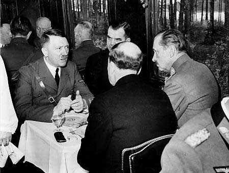 June 4, 1942. Dining in the train wagon: Adolf Hitler (left), Finnish Prime Minister Jukka Rangell, President Risto Ryti (back toward the camera),  Finnish military commander, Marshal Carl Gustav Mannerheim (right).